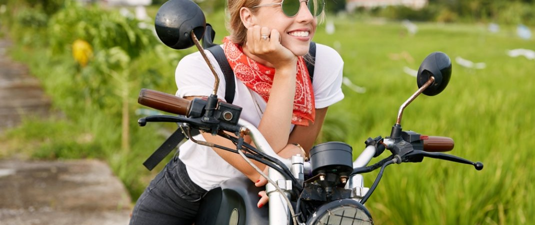 portrait-of-happy-thoughtful-female-biker-in-fashionable-sunglasses-and-casual-t-shirt-feels-free-and-relaxed-as-sits-on-her-favorite-motorbike-and-admires-landscapes-in-countryside-calm-atmosphere-1-60ec57024383d201379594.jpg